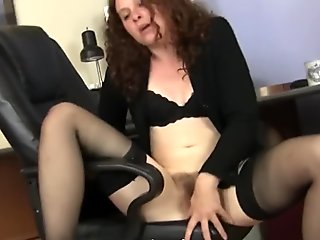Mature Fiona plays with her hairy white pussy