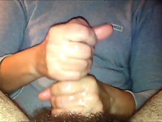 Stroking his hairy cock to orgasm