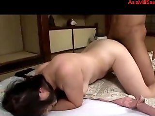 Petite Asian milf loves it from behind