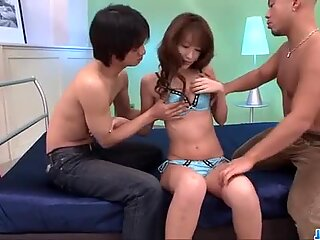 Cute?  Rika Kurachi enjoys two guys to pump her hard