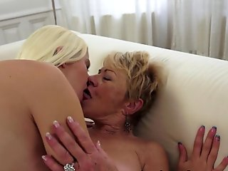 This horny granny needs her wet pussy swallowed, and young hottie does it
