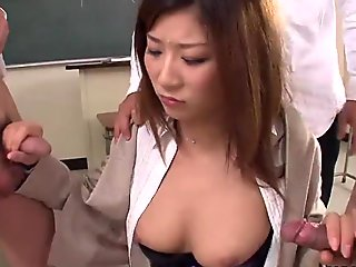 Naughty Japanese teacher sucking off her students