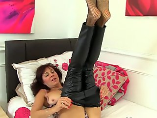 British milf Georgie fucks her hairy pussy with a dildo