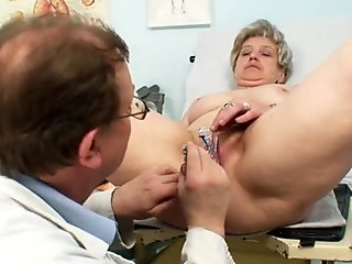 Lustful granny Ruzena pokes her pussy with dildo in front of doctor