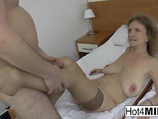 Blonde mature gets her big natural tits covered in cum