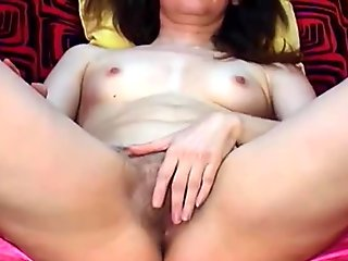 Mature brunette with hairy pussy and small tits