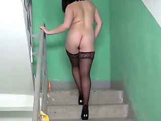 Russian girl with hairy by a pussy, walking naked in a public stairwell