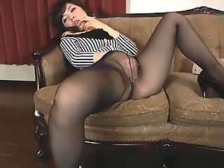 Nice Japanese slut in pantyhose rubs her pussy and cums